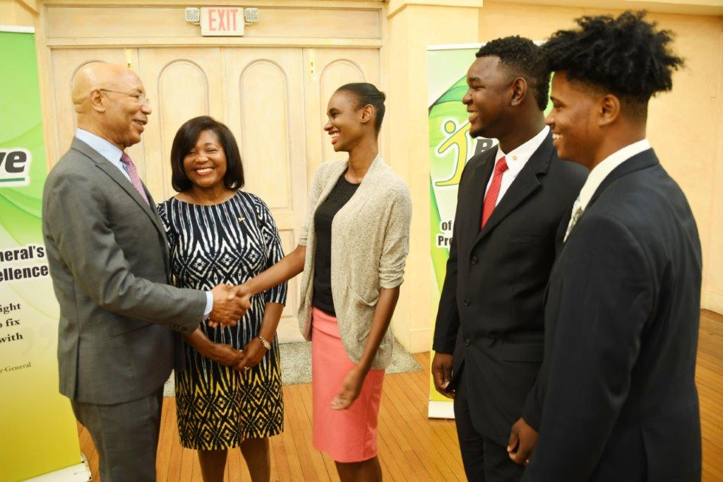 Their Excellencies Sir Patrick Allen and Lady Allen congratulate the top three winners in the 2017 I Believe Initiative Summer Of Service Competition. L-R: Ms. Leneka Rhoden (1st), Mr. Vashawn Saxton (2nd) and Mr. Timothy Simmonds (3rd).